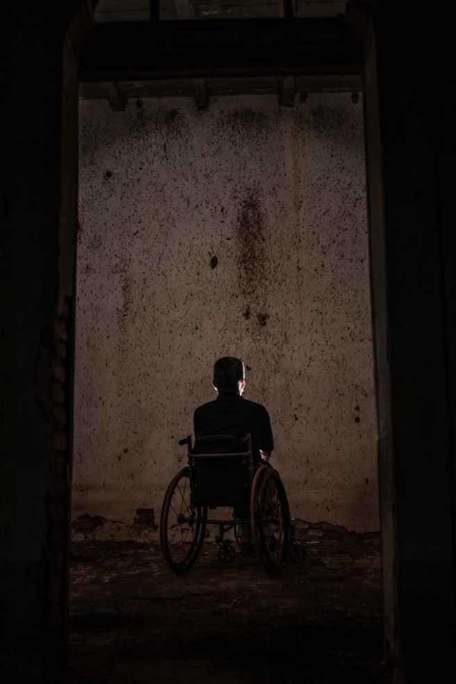 man sitting on a wheelchair