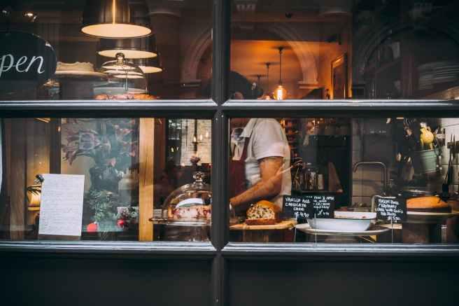 woman in restaurant wearing apron